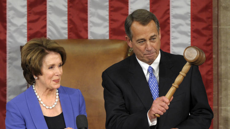 House Minority Leader Nancy Pelosi of Calif. applauds after handing the gavel to House Speaker John Boehner of Ohio who was re-elected as House Speaker of the 113th Congress, Thursday, Jan. 3, 2013, on Capitol Hill in Washington. (AP Photo/Susan Walsh)