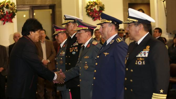 Bolivia's President Morales shakes hands with Army General Vegazo, new chief commander of Bolivia's armed forces, during a swearing-in ceremony in La Paz