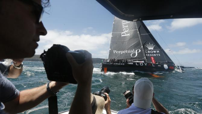 Photographers on a boat capture pictures of Perpetual Loyal as they head out to the Pacific Ocean at the start of the Sydney to Hobart Yacht Race