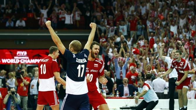 Poland's team celebrate winning their semifinal match against Germany at the FIVB Volleyball Men's World Championship Poland 2014 at Spodek Arena in Katowice