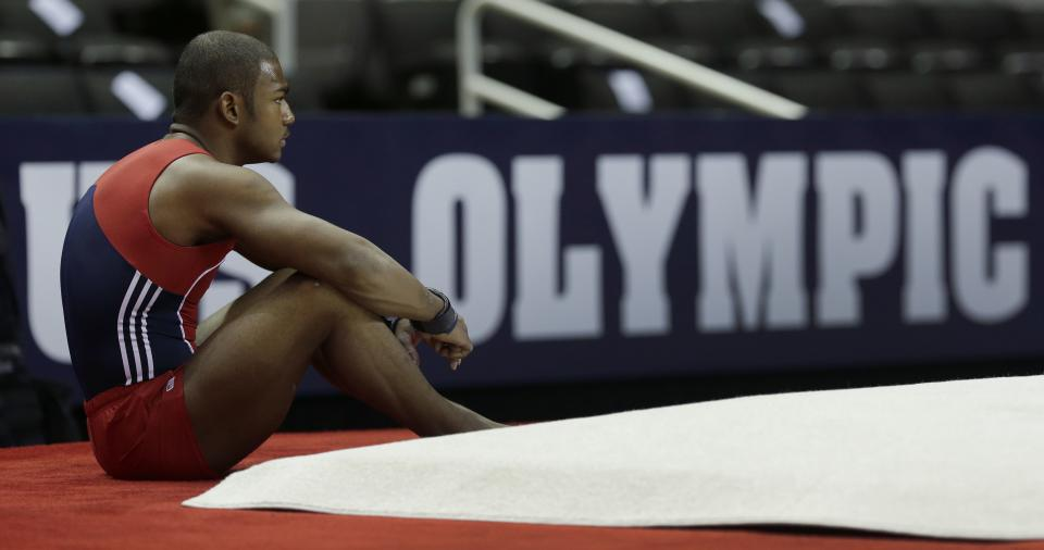 John Orozco takes a break during warm-ups for the men's final round of the  Olympic gymnastics trials, Saturday, June 30, 2012, in San Jose, Calif. (AP Photo/Jae C. Hong)