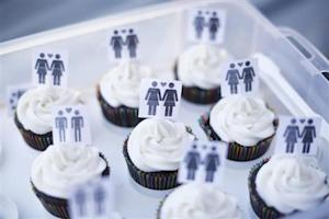 A box of cupcakes are seen topped with icons of same-sex couples at City Hall in San Francisco