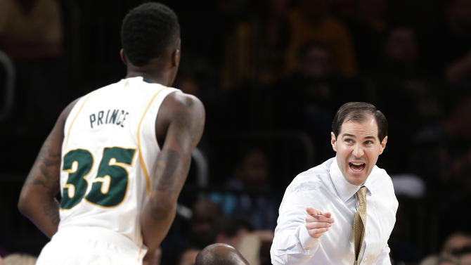 Baylor coach Scott Drew talks to Taurean Prince (35) during the first half of the NIT championship basketball game against Iowa on Thursday, April 4, 2013, in New York. (AP Photo/Frank Franklin II)