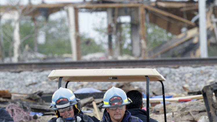 Investigators drive into the destroyed fertilizer plant in West, Texas, Thursday, May 2, 2013. Investigators face a slew of challenges in figuring out what caused the explosion at the fertilizer plant that killed 14 people and destroyed part of the small Texas town.  (AP Photo/LM Otero, Pool)