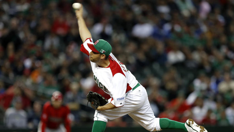 Mexico's Marco Estrada throws against Canada during the first inning of a World Baseball Classic baseball game, Saturday, March 9, 2013, in Phoenix. (AP Photo/Matt York)