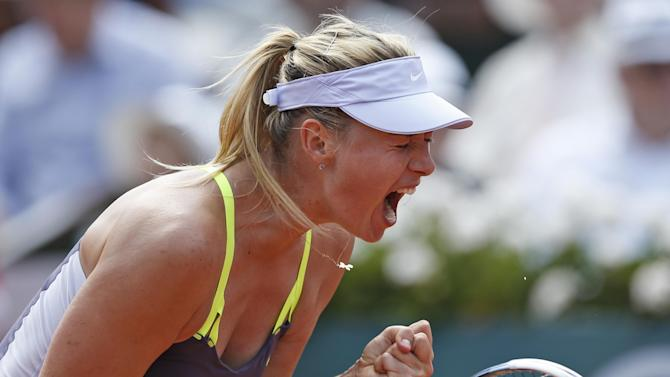 Russia's Maria Sharapova celebrates scoring against Serbia's Jelena Jankovic in their quarterfinal match at the French Open tennis tournament, at Roland Garros stadium in Paris, Wednesday June 5, 2013. Sharapova won in three sets 0-6, 6-4, 6-3. (AP Photo/Petr David Josek)