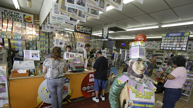 Customers purchase Powerball tickets seeking a payout of around $475 million at a convenience store, Thursday, May 16, 2013, in Orlando, Fla.  The prize is the third largest in lottery history, and the winning numbers will be drawn on Saturday. (AP Photo/John Raoux)