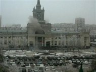 A still image taken from a CCTV footage shows smoke rising after an explosion at a train station in Volgograd December 29, 2013. REUTERS/Reuters TV