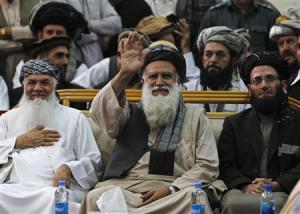 Afghan Mujahideen leader Sayyaf waits with his vice-presidential nominees to register as a candidate for the presidential election in Kabul