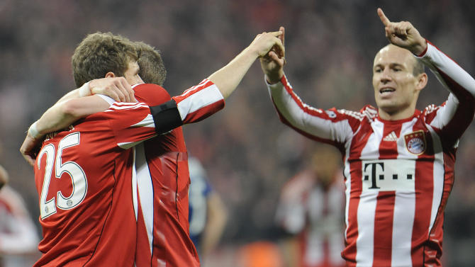 Munich's Thomas Mueller, Bastian Schweinsteiger and Arjen Robben, from left, celebrate after scoring during the Champions League round of 16 second leg soccer match between FC Bayern Munich and Inter Milan in Munich, southern Germany, Tuesday, March 15, 2011. (AP Photo/Kerstin Joensson)