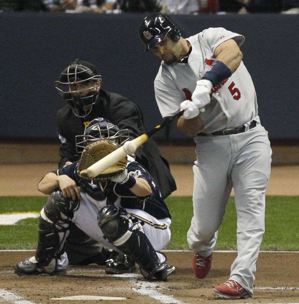 St. Louis Cardinals' Albert Pujols hits a two-run home run during the first inning of Game 2 of baseball's National League championship series against the Milwaukee Brewers Monday, Oct. 10, 2011, in Milwaukee. (AP Photo/Jeff Roberson)