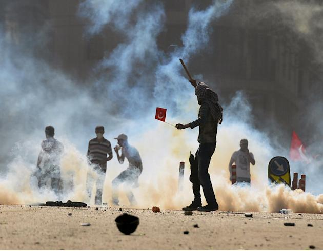 Turkish protesters clash with riot police at the city's main Taksim Square in Istanbul, Turkey, Saturday, June 1, 2013. Turkish police retreated from a main Istanbul square Saturday, removing barricad
