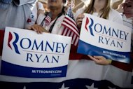 Supporters hold campaign signs as US Republican presidential candidate Mitt Romney and his running mate Paul Ryan speak at a campaign rally in Manassas, Virginia, on August 11. Romney and Ryan will try to energize supporters in North Carolina Sunday after they hit the road on a bus tour across must-win US states, selling themselves as the duo who can &quot;save the American dream.&quot;
