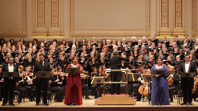 In this Dec. 5, 2012 photo provided by Carnegie Hall, soloists from left, Nicholas Houhoulis, Nicholas Pallesen, Jamie Barton, Angela Meade and Michael Spyres, perform Bellini&#39;s &quot;Beatrice di Tenda&quot; at Carnegie Hall in New York. James Bagwell, center, conductors, the Collegiate Chorale and the American Symphony Orchestra in the seldom-performed work. (AP Photo/Carnegie Hall, Erin Baiano)