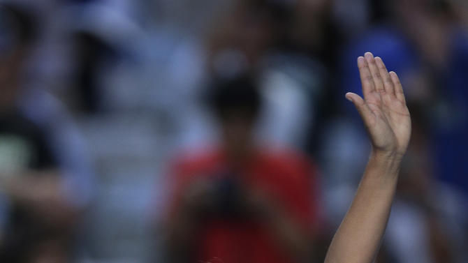 Russia's Maria Sharapova waves to the crowd after defeating Japan's Misaki Doi during their second round match at the Australian Open tennis championship in Melbourne, Australia, Wednesday, Jan. 16, 2013. (AP Photo/Rob Griffith)