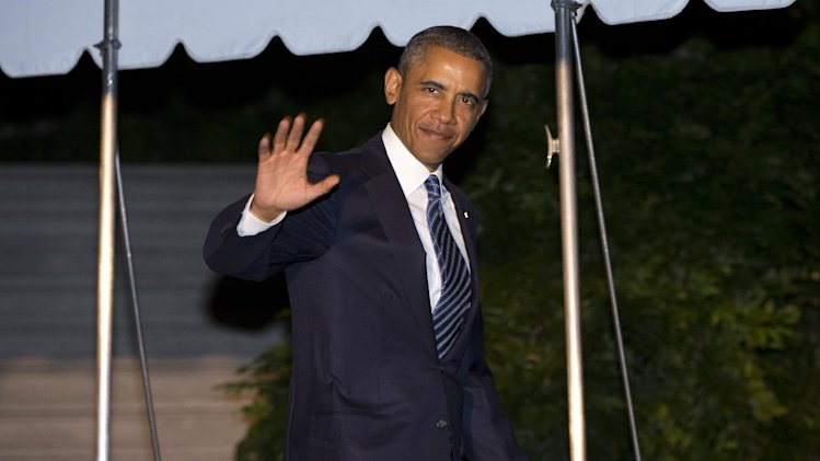 President Barack waves as he walks to board Marine One on the South Lawn of the White House on Tuesday, Sept. 3, 2013 in Washington. Deep uncertainty surrounding military action against Syria hangs over Obama's three-day overseas trip to Sweden and Russia, which takes him away from Washington just as he's seeking support on Capitol Hill for a strike. (AP Photo/Evan Vucci)