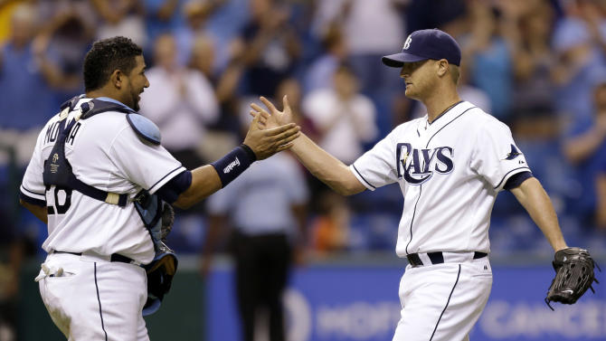 Tampa Bay Rays catcher Jose Molina, left, congratulates starting pitcher Alex Cobb after the Rays shut out the Oakland Athletics 5-0 during a baseball game Thursday, Aug. 23, 2012, in St. Petersburg, Fla. (AP Photo/Chris O'Meara)