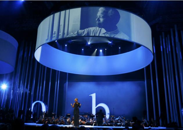 Mary J. Blige performs as the portrait of late Mandela is projected on a screen during the Nobel Peace Prize concert in Oslo
