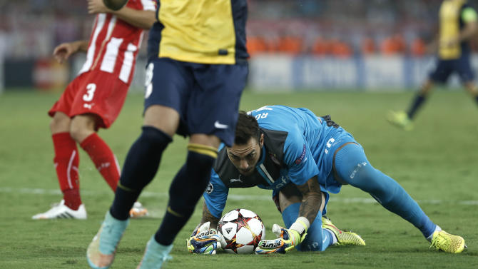 Olympiacos' goalkeeper Roberto saves the ball during a Champions League Group A soccer match between Olympiakos and Atletico Madrid at Georgios Karaiskakis Stadium in the port of Piraeus near Athens, Tuesday, Sept. 16, 2014. (AP Photo/Petros Giannakouris)