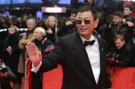 Chinese director Wong Kar Wai poses on the red carpet on arrival for the opening film of the Berlinale film festival, &quot;Yi dai zong shi&quot; (&quot;The Grandmaster&quot;) in Berlin on February 7, 2013