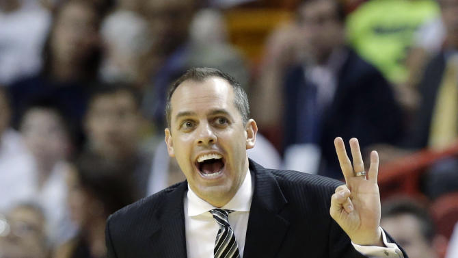 Indiana Pacers head coach Frank Vogel signals to his team during the first half of Game 2 in their NBA basketball Eastern Conference finals playoff series against the Miami Heat, Friday, May 24, 2013, in Miami. (AP Photo/Lynne Sladky)
