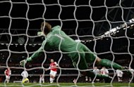 Fulham goalkeeper Mark Schwarzer saves the penalty taken by Arsenal's Spanish player Mikel Arteta. Arteta's last-gasp failure from the spot meant Arsenal's hopes of a top-four place faded a little further in an entertaining 3-3 draw at home