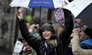 Olympic Torch Route Lashed By Heavy Rain