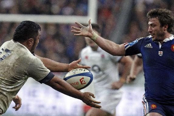 England's Mako Vunipola, left, and France's Maxime Medard, vie for the ball, during their Six Nations rugby union international match, at the Stade de France, in Saint Denis, outside Paris, Sa