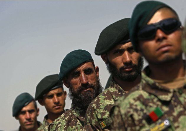 Newly graduated Afghan National Army soldiers attend their graduation ceremony in Kabul