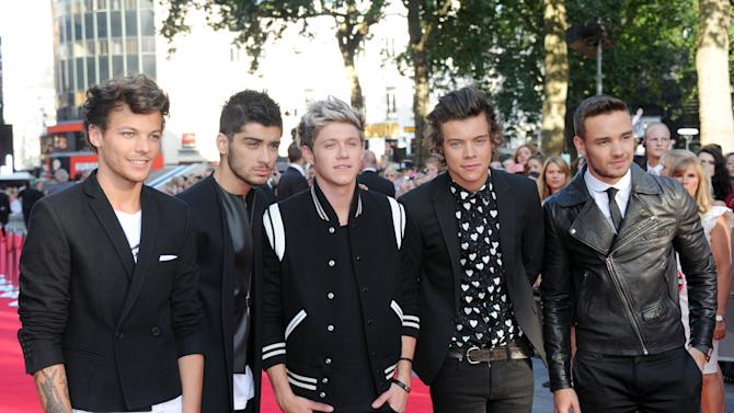 Louis Tomlinson, Zayn Malik, Niall Horan, Harry Styles and Liam Payne arrive at the UK Premiere of 'One Direction: This Is Us 3D' - VIP Arrivals, on Tuesday August 20, 2013, in London. (Photo by Jon Furniss/Invision/AP Images)