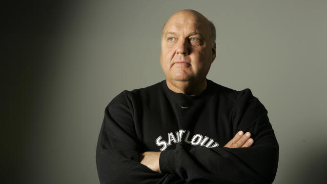 FILE - In this Oct. 30, 2007, file photo,  St. Louis basketball coach Rick Majerus poses for a photo in St. Louis. Majerus, the jovial college basketball coach who led Utah to the 1998 NCAA final and had only one losing season in 25 years with four schools, died Saturday, Dec. 1, 2012. He was 64. (AP Photo/Jeff Roberson, File)