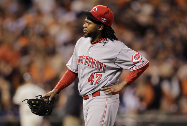 1st Cincinnati Reds starting pitcher Johnny Cueto heads to the dugout after pitching in the first inning of Game 1 of the National League division baseball series against the San Francisco Giants in S