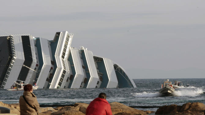 People view the cruise ship Costa Concordia as it lays on its side after running aground off the tiny Tuscan island of Giglio, Italy, Thursday, Jan. 19, 2012.  Divers have resumed the search for 21 people still missing after a cruise ship capsized off the Tuscan coast. The $450 million Costa Concordia cruise ship was carrying more than 4,200 passengers and crew when it slammed into a reef Friday, Jan.16, after the captain made an unauthorized maneuver. (AP Photo/Gregorio Borgia)