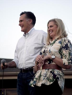 Republican presidential candidate former Massachusetts Gov. Mitt Romney, left, and his wife Ann laugh while greeting an overflow audience during a campaign stop in Vernon Hills, Ill., Sunday, March 18, 2012. (AP Photo/Steven Senne)