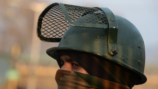 An Indian policeman looks on during search operations in Srinagar on January 25, 2016