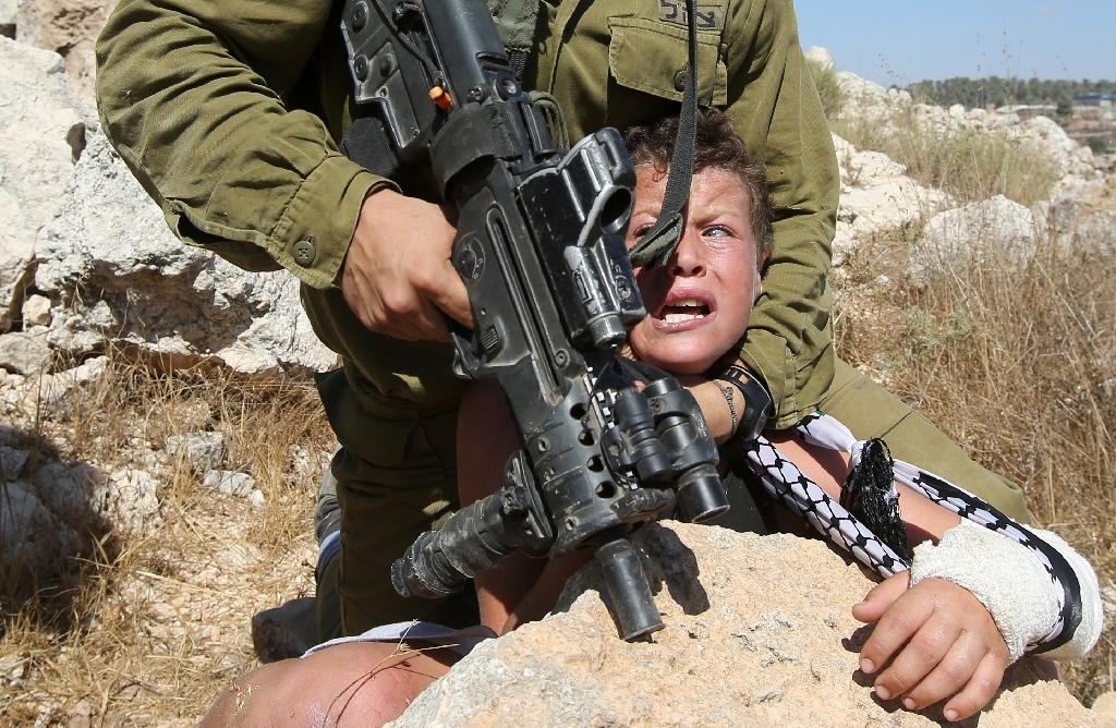 Video of Israeli soldier arresting boy becomes latest in war of perception