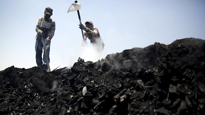 A labourer works at a traditional charcoal factory at a village in Qaha, El-Kalubia governorate, near Cairo