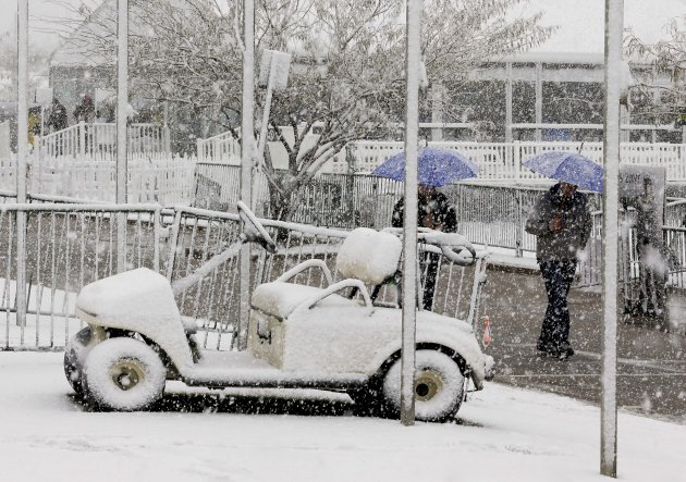 Snow covers a golf cart outside the course clubhouse during the Match Play Championship golf tournament, Wednesday, Feb. 20, 2013, in Marana, Ariz. Play was suspended for the day. (AP Photo/Ted S. War
