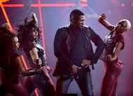 Usher performs at the 40th Annual American Music Awards on Sunday, Nov. 18, 2012, in Los Angeles. (Photo by John Shearer/Invision/AP)