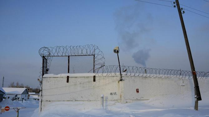 Smoke rises over a fence of a prison camp where jailed feminist punk band Pussy Riot member Maria Alekhina, unseen, serves her term, in the town of Berezniki, some 1500 km (940 miles) north-east of Moscow, Russia, on Wednesday, Jan. 16, 2013. A Russian court on Wednesday turned down her attempt to defer serving her sentence until her preschool son becomes a teenager. Alekhina  was convicted last year along with two other band members of hooliganism motivated by religious hatred for an anti-President Vladimir Putin stunt in Russia's main cathedral. (AP Photo/Alexander Agafonov)
