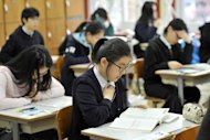 South Korean students prepare to take a test in 2011. Asian parents are spending billions of dollars on private tutors for their children, and the practice is growing despite doubts over its effectiveness, according to a study published Wednesday
