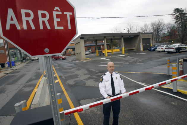 In this Nov. 14, 2012 photo, Miguel Begin, the chief of operations for the Canada Border Services Agency's Stanstead sector, stands at the Canadian port of entry in Stanstead, Quebec. Canadian immigra