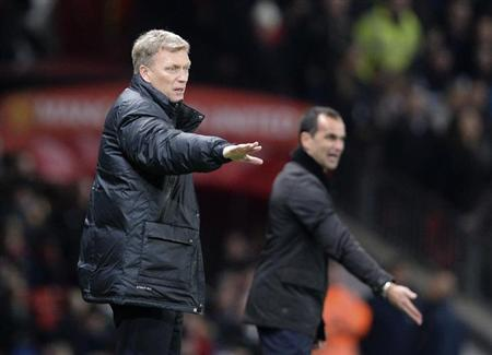 Manchester United manager David Moyes (L) and Everton manager Roberto Martinez direct their teams during their English Premier League soccer match at Old Trafford in Manchester, northern England Decem