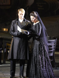 "In this March 2, 2013 photo provided by the Vienna State Opera Toby Spence in the role of Don Ottavio and Marina Rebeka as Donna Anna perform during a dress rehearsal for Wolfgang Amadeus Mozart's opera ""Don Giovanni"" at the state opera in Vienna, Austria. (AP Photo/Vienna State Opera, Michael Poehn)"