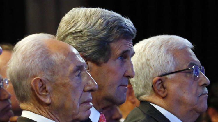 U.S. Secretary of State John Kerry, Israeli President Shimon Peres, left, and Palestinian President Mahmoud Abbas, right, participate in the World Economic Forum on the Middle East and North Africa at the King Hussein Convention Center at the Dead Sea in Jordan Sunday May 26, 2013. (AP Photo/Pool, Jim Young)