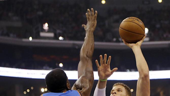 Los Angeles Clippers forward Blake Griffin (32) shoots as Oklahoma City Thunder center Kendrick Perkins (5) defends in the first half of an NBA basketball game in Los Angeles, Sunday, March 3, 2013. (AP Photo/Reed Saxon)