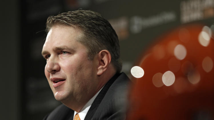 Rob Chudzinski answers questions at a news conference introducing him as the new head coach of the Cleveland Browns at the NFL football team's practice facility in Berea, Ohio Friday, Jan. 11, 2013. (AP Photo/Mark Duncan)