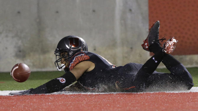 Utah defensive back Davion Orphey scores on a fumble recovery in the first quarter during an NCAA college football game against Southern California on Saturday, Oct. 25, 2014, in Salt Lake City. (AP Photo/Rick Bowmer)