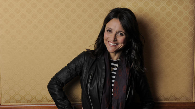 "Julia Louis-Dreyfus, a cast member in the film ""Enough Said,"" poses for a portrait on day 4 of the 2013 Toronto International Film Festival on Sunday, Sept. 8, 2013 in Toronto. From ""Seinfeld"" to ""Veep,"" Louis-Dreyfus has been perhaps the finest comedic actress of her generation, she has stuck largely to the small screen ""much to my agent's chagrin,"" she says. (Photo by Chris Pizzello/Invision/AP)"