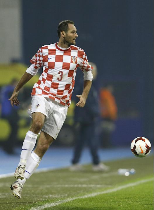 In this Nov. 19, 2013 file picture Croatia's defender Josip Simunic, plays the ball during  a World Cup qualifying playoff second leg soccer match against Iceland, in Zagreb, Croatia. Croatia's World
